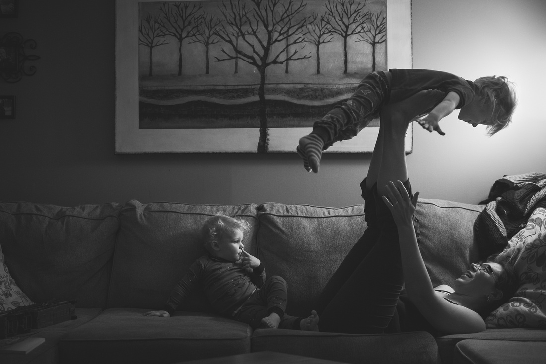 mom playing on couch with kids