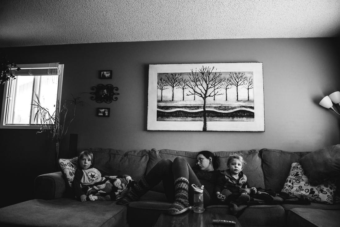 mom sitting on couch with kids